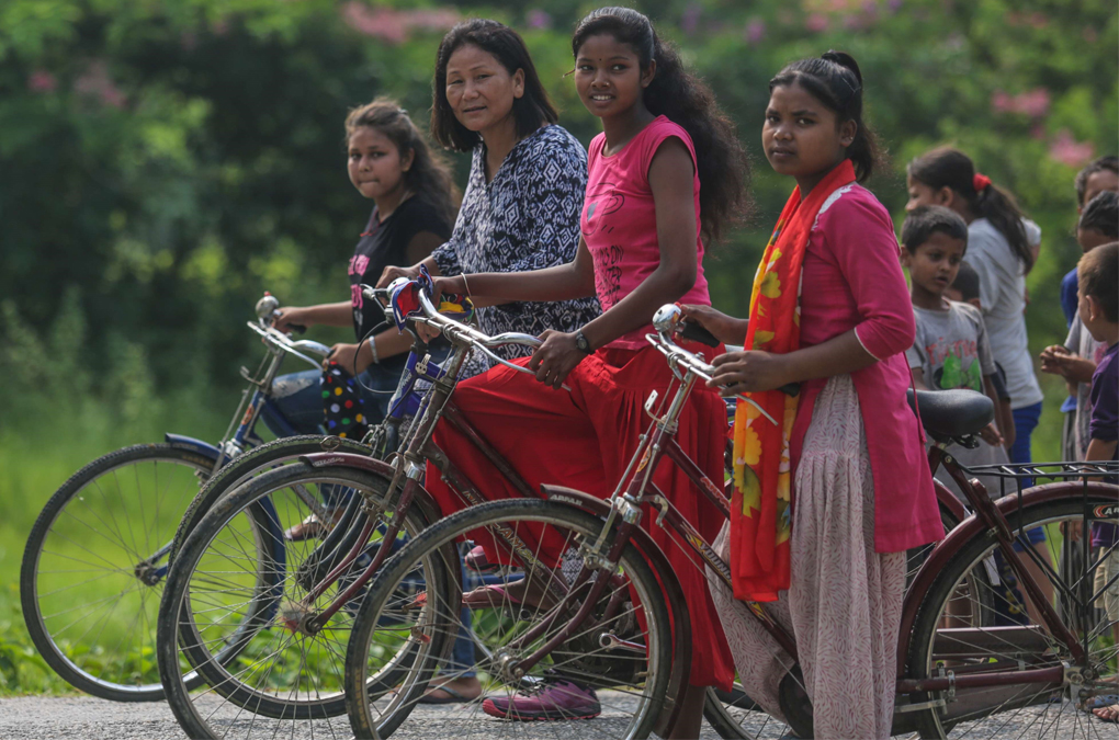 Indira Ranagamar Cycling with her Girls